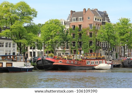 Amsterdam canals and typical houses , Netherlands ( Holland ) - stock photo