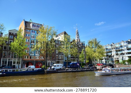 Amsterdam canals and typical houses with clear summer sky, Netherlands - stock photo