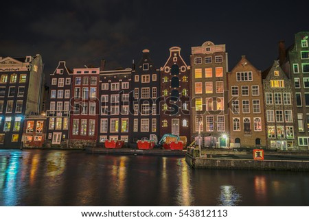 Amsterdam canals with historical houses at the amsterdam light festival Netherlands Holland December 2016