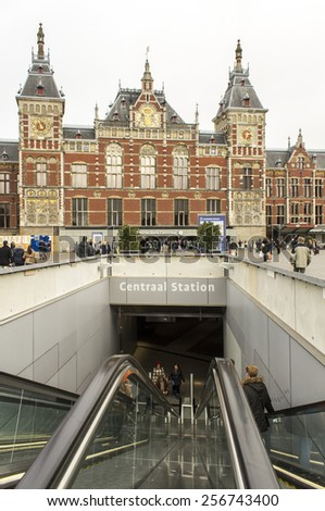 AMSTERDAM - FEBRUARY 07, 2015: Central Station on February 07, 2015 in Amsterdam. Central Station is the central railway station of Amsterdam and is used by 250,000 passengers a day. - stock photo