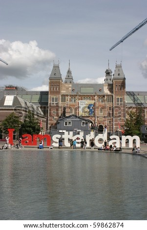 AMSTERDAM, HOLLAND - AUGUST, 25: tourists wait to enter The Rijksmuseum, one of the most famous museum in Europe, on August 25, 2010 in Amsterdam, Holland