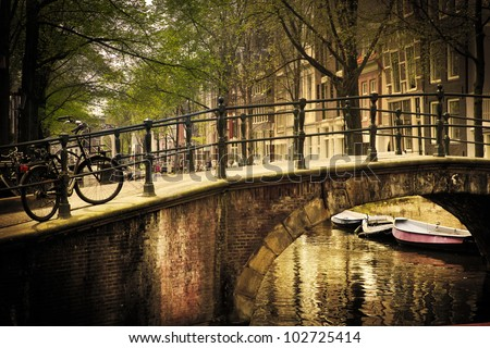 Amsterdam, Holland, Netherlands. Romantic bridge over canal. Old town - stock photo