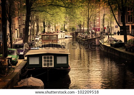 Amsterdam, Holland, Netherlands. Romantic canal, boats. Old town - stock photo
