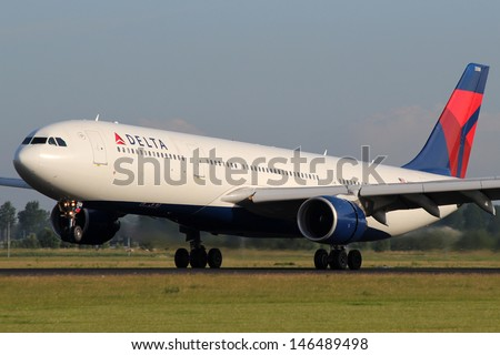 AMSTERDAM - JULY 02: Delta Air Lines Airbus A330 lands at AMS Airport in Netherlands on July 02, 2012.  Delta is one of the biggest airlines in the world serve over 300 destinations around the world - stock photo