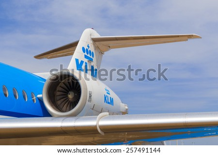 AMSTERDAM - 19 JULY, 2014: The KLM Cityhopper Fokker 70 is powered by two Rolls-Royce Tay 620 turbofans placed at the back of the fuselage. - stock photo