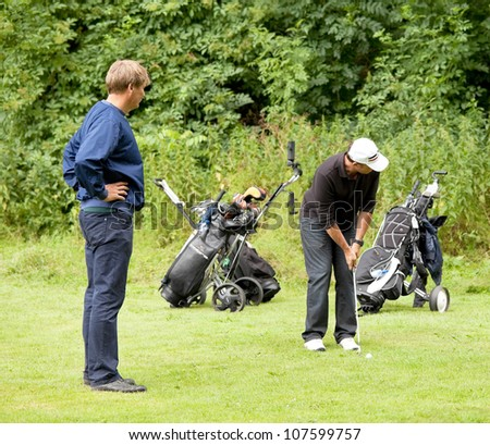 AMSTERDAM - JULY 11: Unidentified golfers participate in AH&BC Open, golf charity event, held in the Amsterdamse Bos, on July 11, 2012 in Amsterdam, The Netherlands