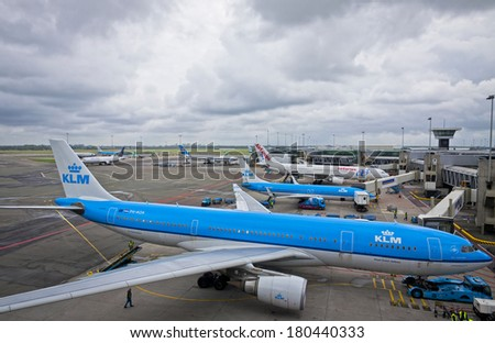 AMSTERDAM - JUNE 23, 2013: Amsterdam Airport Schiphol, the main international airport of the Netherlands. Schiphol is an important European airport, ranking as 4th busiest by passenger traffic in 2012