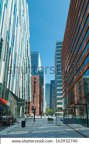 AMSTERDAM - JUNE 30: Street in the Amsterdam Zuidas (South axis) business district on June 30, 2013 in Amsterdam.The area is known as an international high level knowledge and business center