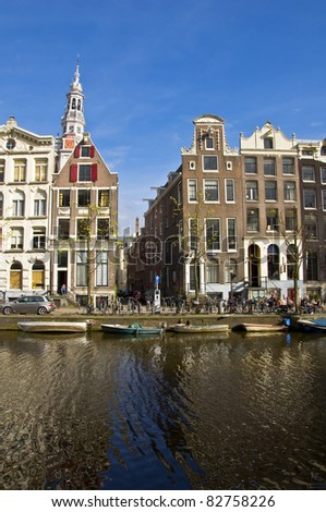 Amsterdam Life. Residential homes on the canal. Urban scene. Spring. - stock photo