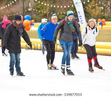 AMSTERDAM - MAR 24: Unidentified city natives participate in the annual KPN Skating Friends Day, organized by the Dutch Foundation for Disability Sport, March 24, 2013, in Amsterdam, The Netherlands