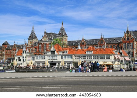 AMSTERDAM - MAY 13, 2016: Centraal Train Station is major national railway hub and used by 260,000 passengers a day