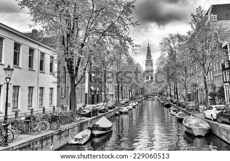 AMSTERDAM - MAY 1, 2013: Cityscape on a beautiful spring day. Amsterdam attracts more than 4 million tourists annually