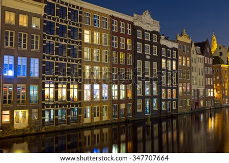 Amsterdam medieval houses by night in the Netherlands