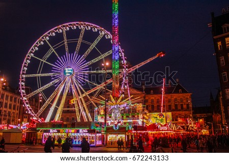 AMSTERDAM, NETHERLANDS - APR 16, 2017 - Amusement Park Downtown Colorful Illuminated Night View Damrak Square