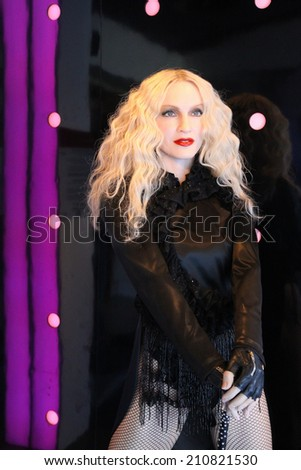 Amsterdam, Netherlands - April 12, 2013: Madame Tussauds wax museum is one of the biggest tourist attractions in the city. Here: American singer Madonna. - stock photo