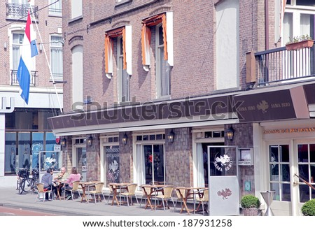 AMSTERDAM, NETHERLANDS - APRIL 3: Terrace in front of restauration in city Amsterdam on April 3, 2014 in Amsterdam