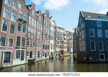 Amsterdam, Netherlands - April 20, 2017: Traditional old buildings in Amsterdam in spring, the Netherlands