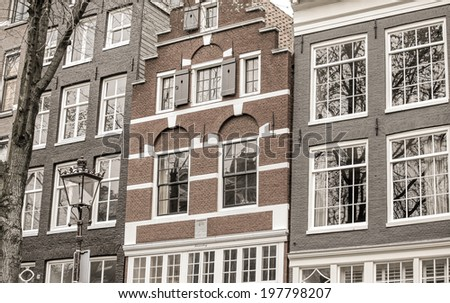 AMSTERDAM, NETHERLANDS - APRIL 3: Typical architecture in city Amsterdam on April 3, 2014 in Amsterdam