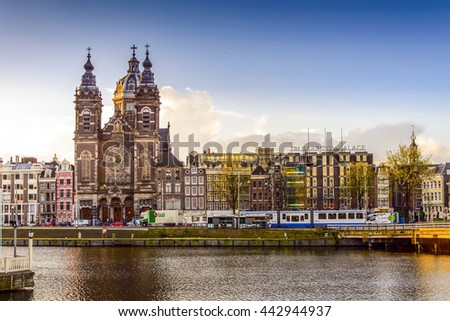 AMSTERDAM, NETHERLANDS - APRIL 7: View of St. Nicolas Church along the river in Amsterdam on April 7, 2016. It is the city's major Catholic church.