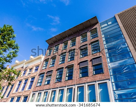 AMSTERDAM, NETHERLANDS - AUG 26: Anne Frank House in Amsterdam, Netherlands on August 26, 2013. Amsterdam is the capital city and most populous city of the Kingdom of the Netherlands. - stock photo
