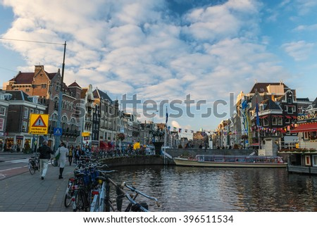 Amsterdam, Netherlands August 2015 : Amsterdam canal scene with bicycles - stock photo