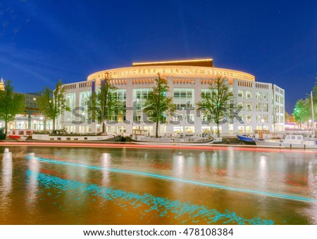 Amsterdam,  Netherlands - August 29, 2016: Building of the National Opera and Ballet Theater in night light. Amsterdam. Netherlands.