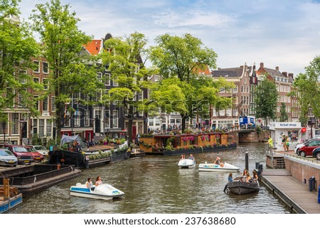 AMSTERDAM, NETHERLANDS - AUGUST 19: Canals of Amsterdam. Amsterdam is the capital and most populous city of the Netherlands on August 19, 2014 - stock photo