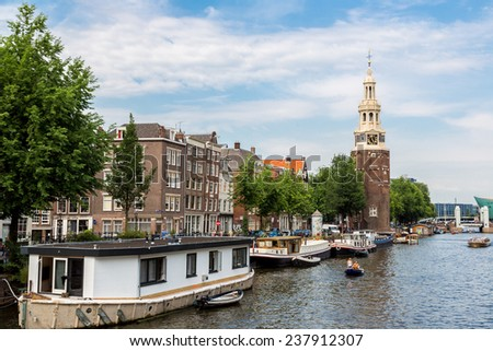 AMSTERDAM, NETHERLANDS - AUGUST 19: Coin Tower (Munttoren) in Amsterdam. Amsterdam is the capital and most populous city of the Netherlands on August 19, 2014