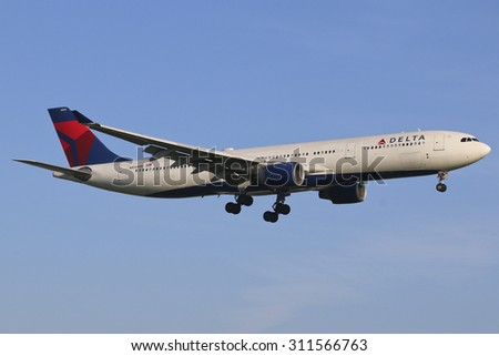 AMSTERDAM, NETHERLANDS - August 9, 2015: Delta Airlines, Airbus A330 aircraft landing at Schipol International Airport early morning, The Netherlands