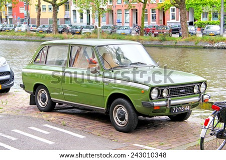 AMSTERDAM, NETHERLANDS - AUGUST 10, 2014: Dutch retro car DAF 66 1300 Marathon at the city street. - stock photo