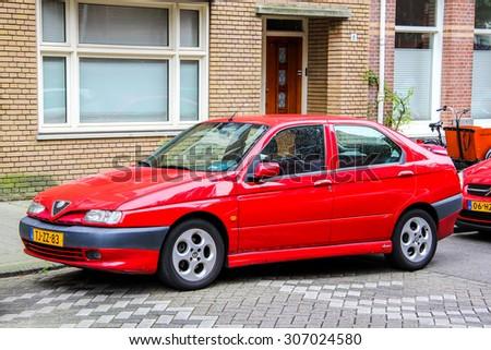 AMSTERDAM, NETHERLANDS - AUGUST 10, 2014: Motor car Alfa Romeo 146 at the city street. - stock photo