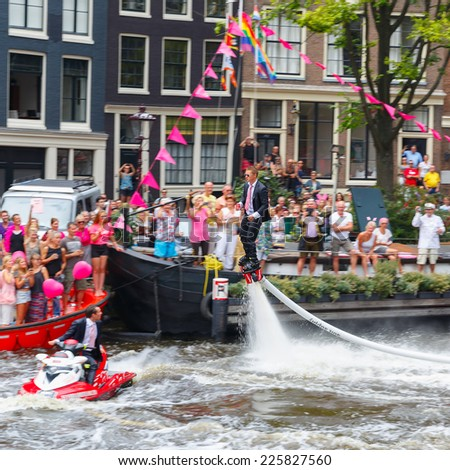 Amsterdam, Netherlands - August 2, 2014: Participants at the famous Canal Parade of the Amsterdam Gay Pride 2014. Focus on the central person.