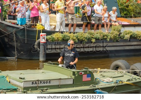 Amsterdam, Netherlands - August 2, 2014:  participants in the annual event for the protection of human rights and civil equality -  Gay Pride - stock photo