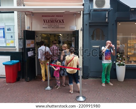 AMSTERDAM - NETHERLANDS: AUGUST 1, 2014: People waiting in line for famous homemade fries. - stock photo