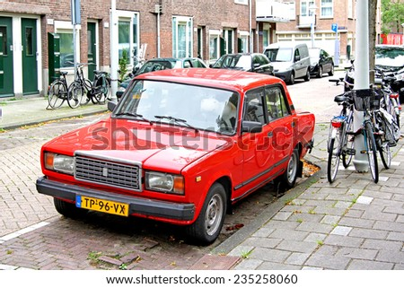AMSTERDAM, NETHERLANDS - AUGUST 10, 2014: Russian retro motor car LADA 2107 at the city street. - stock photo