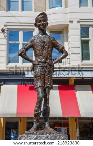 Amsterdam, Netherlands - August 03, 2014: Statue of The Little Darling (Het Lieverdje) on the Spui in Amsterdam