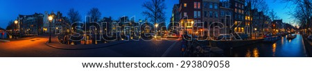 Amsterdam, Netherlands canals and bridges. Night and panoramic view of Keizersgracht and famous touristic place - stock photo