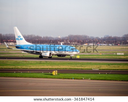 AMSTERDAM, NETHERLANDS - DEC 28, 2015: KLM's aircraft on taxi way at Schiphol air port, Amsterdam, Netherlands. KLM is the oldest airline in the world found in 1919. - stock photo