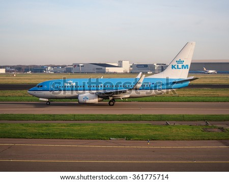 AMSTERDAM, NETHERLANDS - DEC 28, 2015: KLM's aircraft on taxi way at Schiphol airport, Amsterdam, Netherlands. KLM is the oldest airline in the world found in 1919. - stock photo