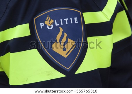 Amsterdam, Netherlands-december 26, 2015: illustrative,editorial, Badge on a uniform of a dutch police officer - stock photo