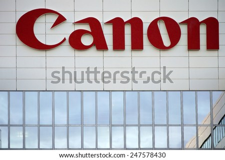 AMSTERDAM, NETHERLANDS - DECEMBER 30: The company's logo from Canon on a modern facade of an office building on December 30, 2014 in Amsterdam / Canon Amsterdam
