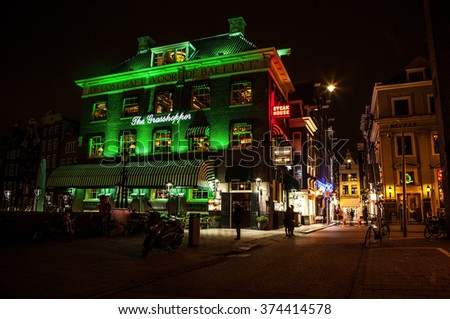 AMSTERDAM, NETHERLANDS - JANUARY 22 2016: City streets of Amsterdam at night. General views of city landscape on January 22, 2016 in Amsterdam - Netherland.