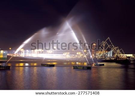 AMSTERDAM, NETHERLANDS - JANUARY 17 2015: Piece of light art at night during the Amsterdam Light festival in Amsterdam, the Netherlands on January 17, 2015 - stock photo