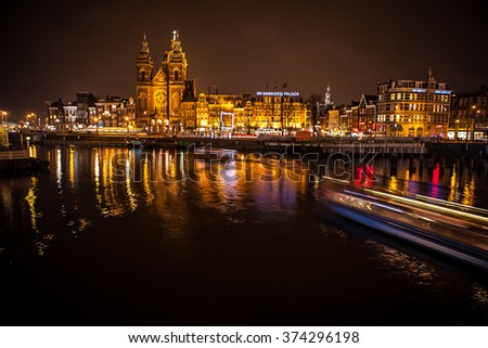 AMSTERDAM, NETHERLANDS - JANUARY 17, 2016: ?ruise boat in night canals of Amsterdam on January 17, 2016 in Amsterdam - Netherland.