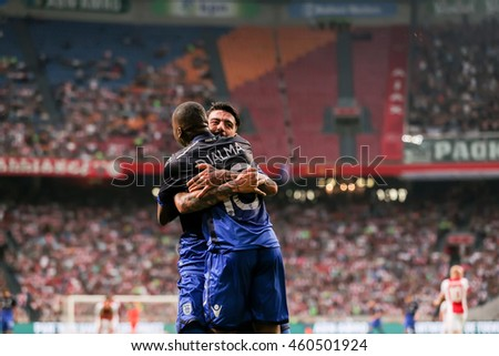 Amsterdam, Netherlands - July 26, 2016: C. Djalma (No10) is congratulated by PAOK team-mate S. Athanasiadis  after scoring during the UEFA Champions League third qualifying round between Ajax vs PAOK