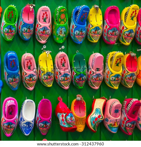 Amsterdam, Netherlands - July 30,2014: Dutch souvenirs clogs - box for shoe brush on the counter in the Souvenir shop in Amsterdam. Wooden shoes clogs, windmills and tulips - the most popular - stock photo