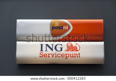Amsterdam,Netherlands-july 27, 2015: Ing service point and postnl shop in Amsterdam