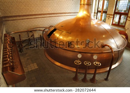 Amsterdam, Netherlands, July 13,2012: One of the big brewery silos inside Heineken Experience at Amsterdam, Netherlands. - stock photo