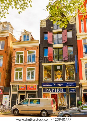 AMSTERDAM, NETHERLANDS - JUN 1, 2015: Architecture of the centre of Amsterdam. Amsterdam is the capital city and most populous city of the Kingdom of the Netherlands