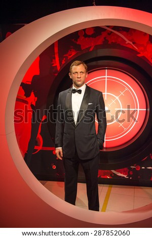 AMSTERDAM, NETHERLANDS - JUN 1, 2015: Daniel Craig as the agent 007 James Bond in Madame Tussauds museum in Amsterdam. Marie Tussaud was born as Marie Grosholtz in 1761 - stock photo